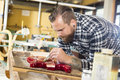 Craftsman Working At Workshop With A Guitar Stock Image - 61582881