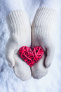Female Hands In White Knitted Mittens With Entwined Vintage Romantic Red Heart On Snow Background. Love And St. Valentine Concept Royalty Free Stock Images - 61586399