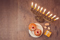 Menorah And Sufganiyot On Wooden Table For Hanukkah Celebration. View From Above Stock Photography - 61606432
