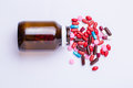 Pills Pouring Out Of The Brown Bottle Royalty Free Stock Photos - 61606818