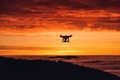 Personal Drone Flying Through The Air At Sunset Stock Photos - 61615293