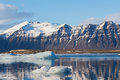 Mountain In Jokulsarlon Lake With Clear Blue Sky Royalty Free Stock Photos - 61630028