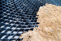 Close Up On Slope Erosion Control Grids On Steep Slope. Royalty Free Stock Images - 61631139