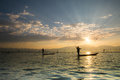 Silhouettes Of The Traditional Fishermen Throwing Fishing Net Du Royalty Free Stock Photo - 61636125