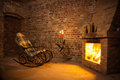 Rocking Chair By The Fireplace In Brick Room Stock Photography - 61636642
