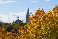 Golden Maple Leaves On The Background The Tower Of The Alexander Lutheran Church. Estonia Royalty Free Stock Images - 61651139