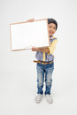 Happy Asian Boy Holding Art Board Stock Photos - 61668603