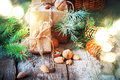 Christmas Light With Presents. Boxes Decorated Cord, Coniferous, Pine Cones, Nuts. Stock Photos - 61681453