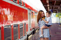 Cute Little Girl And Mother On A Railway Station. Stock Photography - 61685422