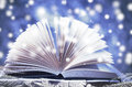 Winter Story. Open Book On Wooden Snowy Blue Background Stock Photo - 61703450