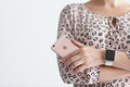 Woman With Apple Watch Holding IPhone 6 S Rose Gold Stock Image - 61704081