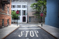 Stop Sign Painted On The Road Stock Image - 61718101