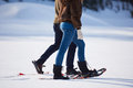 Couple Having Fun And Walking In Snow Shoes Stock Photos - 61720133