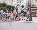 Paris Skater Leaps Plastic Barricade As People Look On Stock Image - 61724401