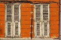 Two Dirty Wooden Closed Shutters In The Old Building Facade Stock Photography - 61747392