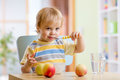 Happy Child Eating Food Cheese With Fruits At Home Royalty Free Stock Images - 61752369