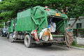Ashman Loads Garbage Into A Truck Stock Photo - 61757050