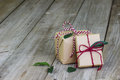 Presents Tied In Red Striped String On Wood Floor Royalty Free Stock Photography - 61760477