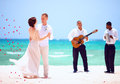 Beautiful Bride And Groom Dancing On Tropical Beach, Live Music Royalty Free Stock Photography - 61775087