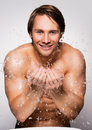 Smiling Man Washing His Healthy Face With Water. Stock Photography - 61778272