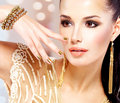 Woman With Golden Nails And Beautiful Gold Jewelry Royalty Free Stock Photography - 61790997