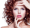 Beautiful  Woman With Brunette Curly Hair Posing At Studio. Royalty Free Stock Photos - 61791368