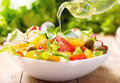 Olive Oil Pouring Over Vegetable Salad Stock Images - 61795174
