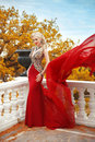 Sexy Young Beauty Woman In Fluttering Red Dress. Elegant Slim La Royalty Free Stock Photography - 61797727
