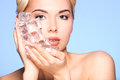 Closeup Portrait Of Beautiful Young Woman Applies The Ice To Fac Stock Photo - 61812280