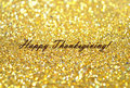 Text Happy Thanksgiving On Blurred Background With Golden Glitter Sparkles Royalty Free Stock Images - 61815939