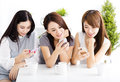 Happy Young Women Watching Smart Phone  In Living Room Royalty Free Stock Photo - 61847405