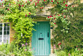 English Cottage Green Doors And Red Roses Stock Photo - 61867230