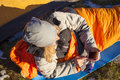 The Girl With The Phone Lying In A Sleeping Bag. Royalty Free Stock Photos - 61875458