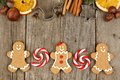 Christmas Gingerbread Cookies, Peppermints And Baking Goods On Rustic Wood Royalty Free Stock Photos - 61876408