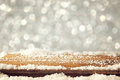 Image Of Wooden Old Table And December Fresh Snow On Top. In Front Of Glitter Background. Selective Focus Royalty Free Stock Photo - 61886885