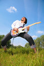 Young Man Plays On Guitar On Grass Stock Photography - 6197122
