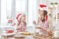 Cooking Christmas Biscuits Stock Images - 61911494