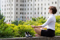Business Woman Relaxing With Yoga In The City Stock Photography - 61915342