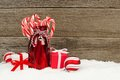 Milk Bottle With Candy Canes, Baubles And Gifts, In Snow Royalty Free Stock Photos - 61930108