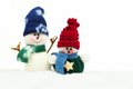 Christmas Snowman Decorations In Fresh Snow Over White Royalty Free Stock Photo - 61930755
