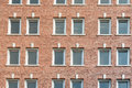 Red Brick Wall With Rows Of Windows Royalty Free Stock Photo - 61951855
