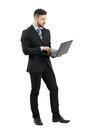 Side View Of Young Businessman In Suit Using Laptop. Stock Photography - 61952922