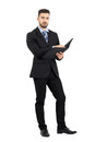 Confident Young Manager Holding Business Files With Paperwork Stock Image - 61953081