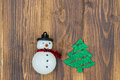 Handmade Snowman With Christmas Tree On Wooden Background Royalty Free Stock Image - 61973616