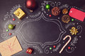 Christmas Holiday Background With Decorations And Hand Drawings On Chalkboard. View From Above Royalty Free Stock Photo - 62002695