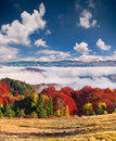 Colorful Autumn Landscape In The Mountain Village. Foggy Morning Royalty Free Stock Photo - 62035745