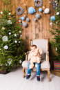 Little Boy Playing With Toys Near Christmas Tree Royalty Free Stock Photos - 62056838