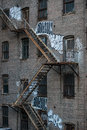 Fire Escape Stairs On An Old Building Exterior In New York, Manhattan Royalty Free Stock Photography - 62077437