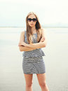 Beautiful Young Woman Wearing A Striped Dress, Sunglasses Royalty Free Stock Photography - 62105877