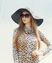 Portrait Of Beautiful Elegant Woman Wearing A Leopard Dress, Straw Hat And Sunglasses Royalty Free Stock Photography - 62105957